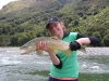 Alex Watson ,the guides daughter with her first fish on the fly at the Lochy River